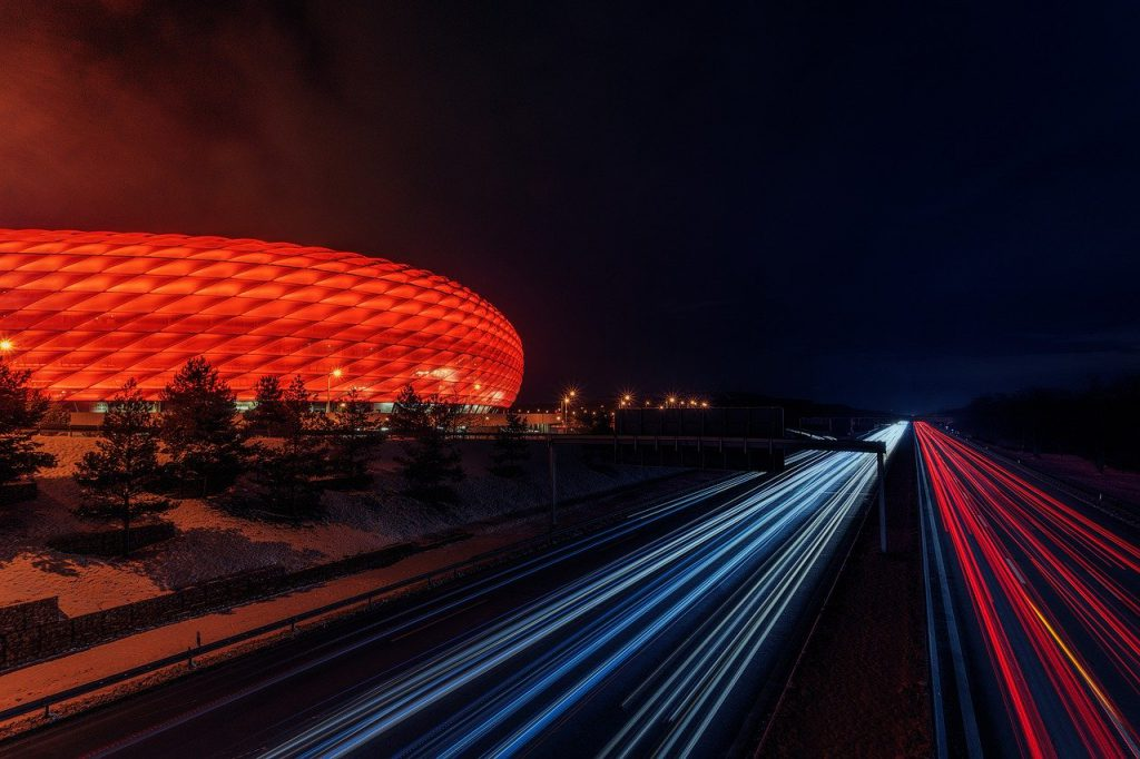 Stadium with car lights moving by