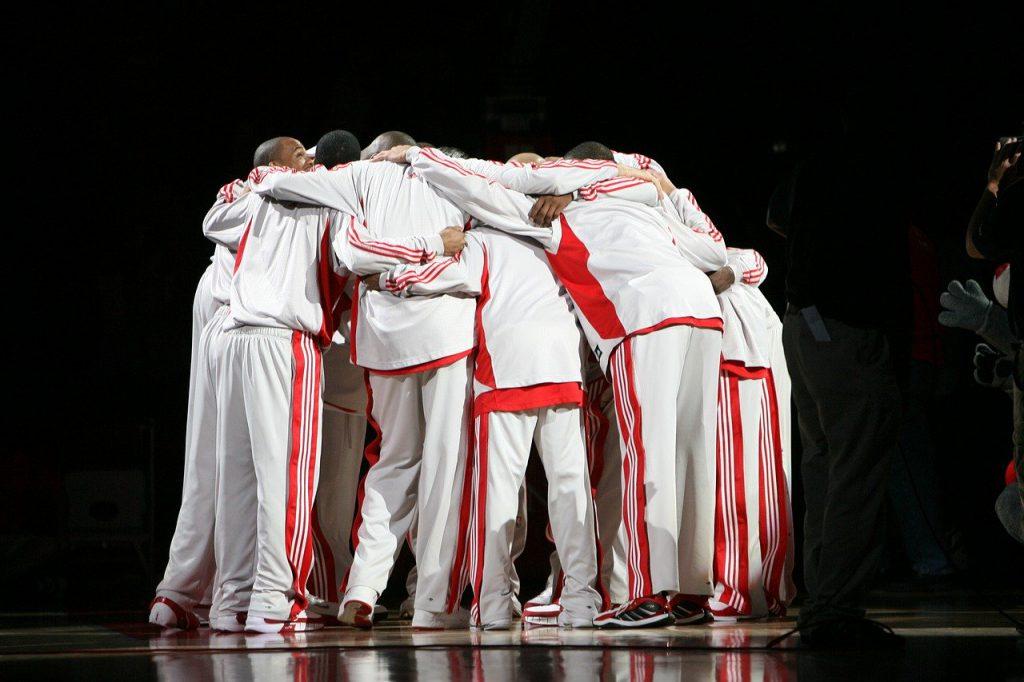NBA team huddling and listening