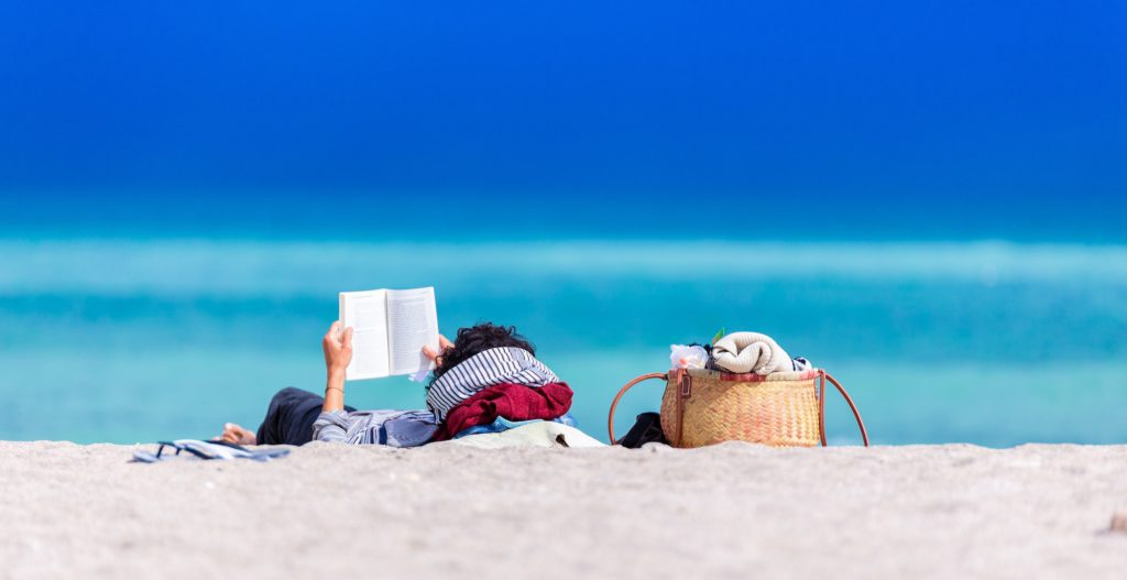 reading on empty beach