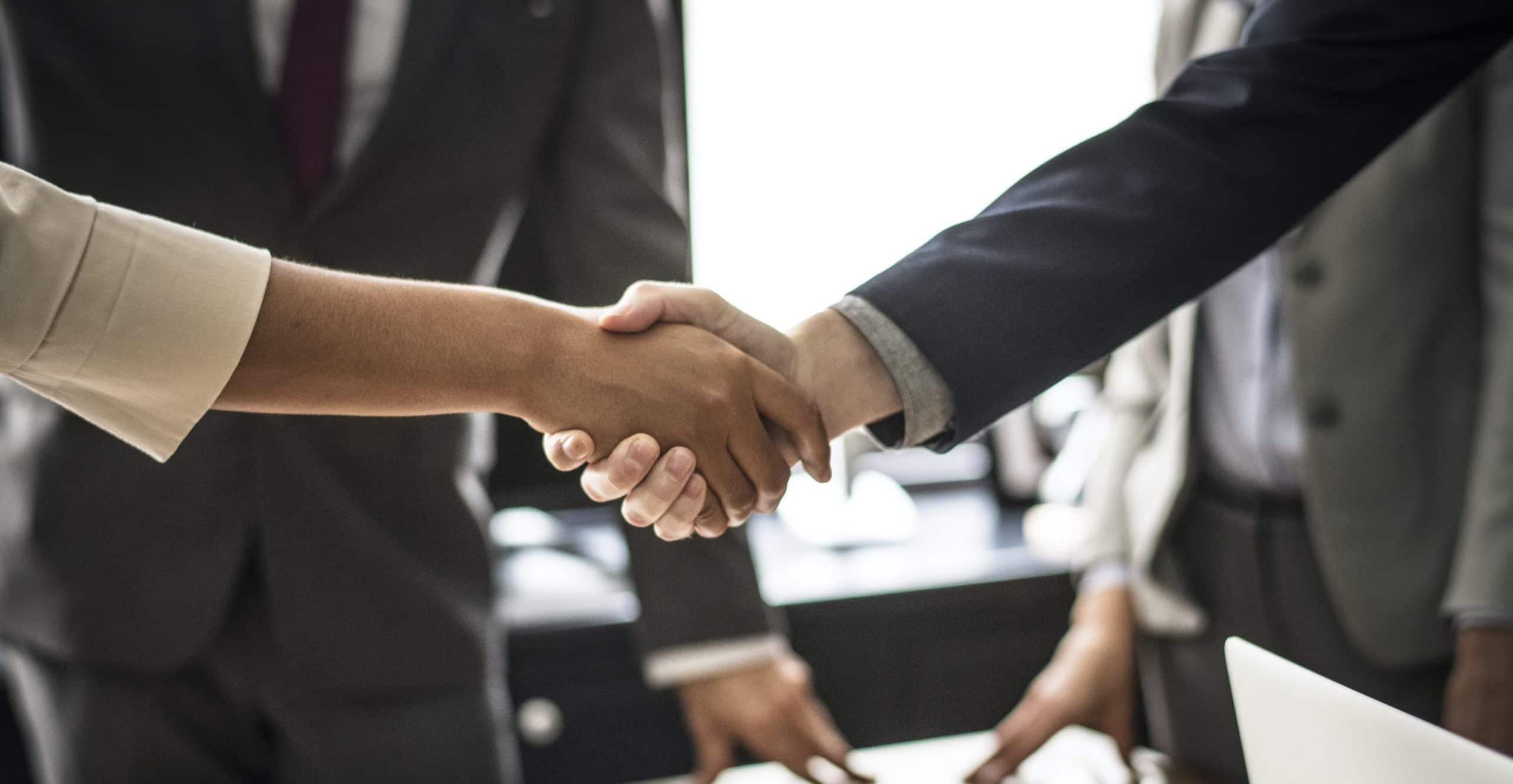 deal shaking hands