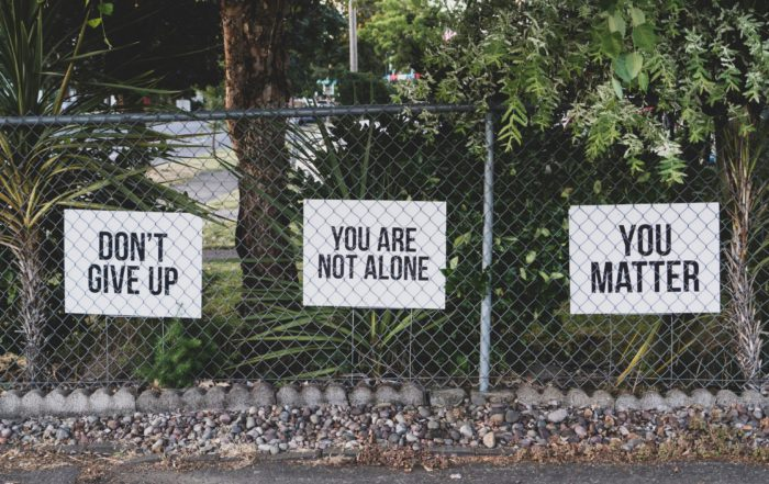 uplifting signs on fence