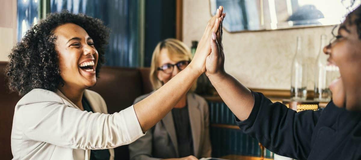 women giving high fives