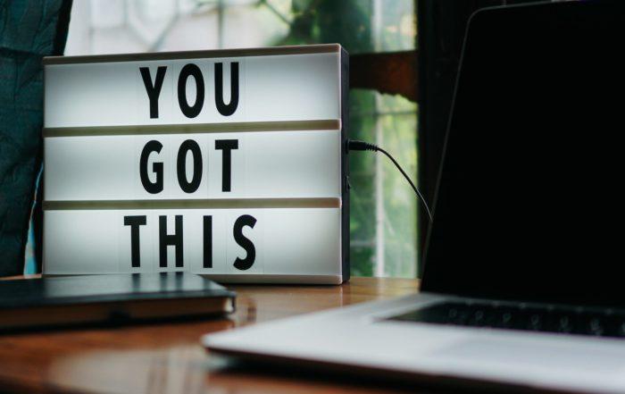 team motivation-- text next to laptop